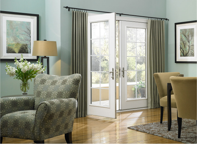 Decorative drapery hardware room scene with UDesign black free traverse rod above a sliding glass door